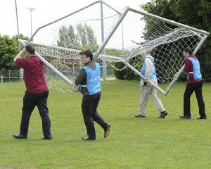 People moving a goalpost